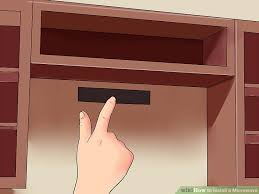How To Build A Wall Cabinet by How To Install A Microwave 12 Steps With Pictures Wikihow