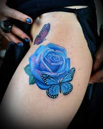 blue and butterfly thigh tattoos