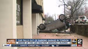 lexus towson md suv crashes off of parking garage in towson driver transported to