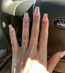 pink nails with swarovski crystal design square tips