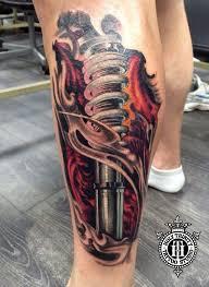 fantastic biomechanical leg tattooed in the studio by cosmo