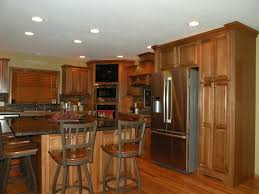 belmont kitchen island decorating peru wooden kraftmaid cabinets with black countertop