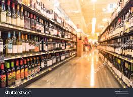 Liquor Display Shelves by Blurred Image Wine Shelves Display Supermarket Stock Photo