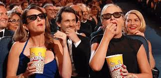 Meme Eating Popcorn - tina fey and amy poehler eating popcorn gifrific