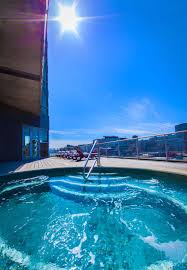 the heated rooftop tub at hotel le crystal is open year round