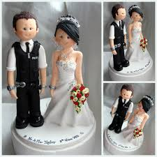 custom wedding cake toppers and groom handcuffed with groom wedding cake topper custom