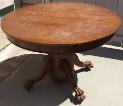 antique round oak claw foot dining or kitchen table w 4 leaf