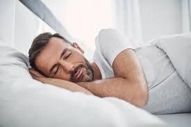 Man Sleeping In Bed Photos Illustrations Et Vidéos De Homme