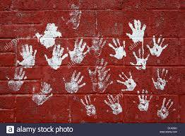 red brick wall with hand prints in white paint kilmarnock