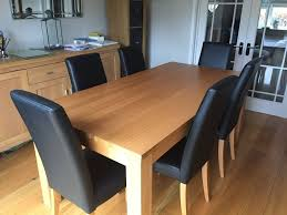 Oak Dining Chairs Solid Oak Dining Table With 6 Black Leather Dining Chairs With