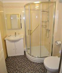 basement bathroom ideas with corner shower stall and mosaic floor