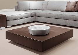 square low profile coffee table painted with brown color on cream