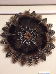 turkey feather wreath all local turkey feather wreath with a pinecone center