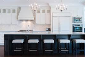 black and white kitchen with calacatta marble moroccan tile