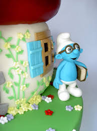spectacular smurfs cake between the pages