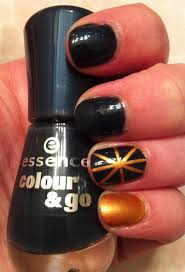 nail art blue and gold sunburst workaday beauty
