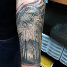 gorgeous colored very detailed eagle head tattoo on forearm with