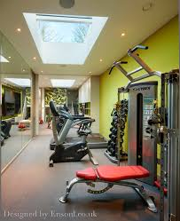 a beautiful home gym in a basement with great natural light from a