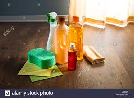 wood floor cleaner products on parquet with sponges and microfiber