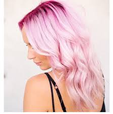 intense deep pink hair color cascading into a delicate pastel hue