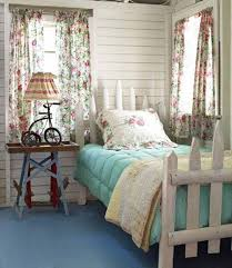 country style bedroom with floral curtains and unique bed frame