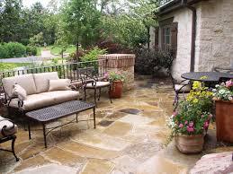 mediterranean inspired courtyards stone flooring garden pots