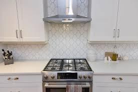 white shaker kitchen cabinets backsplash white shaker kitchen cabinet with arabesque gloss tile
