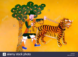tiger wall stock photos tiger wall stock images alamy traditional bhutanese mural art on the wall of paro dzong depicting a mongol leading a tiger