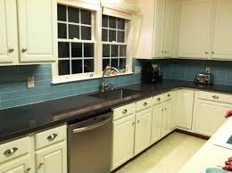 blue backsplash with white stop contact and white laminated wooden