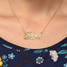 gold necklace with name in cursive this lovely charleston style name necklace uses an easy to read