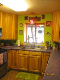 my lime green kitchen wall with purple counter tops in my home