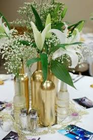 gold centerpieces wine and beer bottles cakes centerpieces
