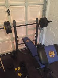 marcy bench press with weights bar preacher pad dumbbells and