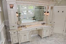 white double master bathroom vanities with makeup area in center