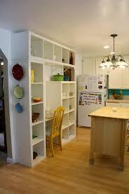 brown island with white granite countertopalso unique kitchen