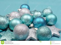 festive background of aqua pale blue christmas glitter baubles