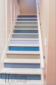 painted basement steps with board and batten to protect walls