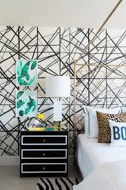 gold quatrefoil headboard with black and white nightstand
