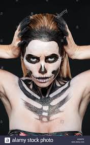 Skeleton Halloween Makeup by Woman With Skeleton Halloween Makeup Over Black Background Stock