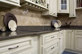heritage white cabinets with quartz counter top and travertine