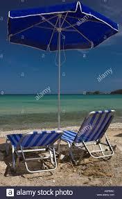 Beach Umbrella And Chair Blue Beach Umbrella And Sun Lounger Chairs On Skala Potamias Beach