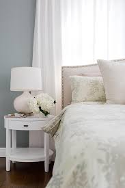 Crate And Barrel Headboard Beige Camelback Headboard With With White Oval Nightstand