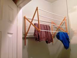 wall mounted drying rack that is great for small laundry room image of wall mount clothes drying rack