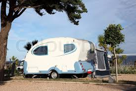 Small Caravan by Small Caravan On A Camping Site Stock Photo Colourbox