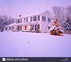 House With Front Porch Snowy Winter View Of Exterior Of Two Story White House With Front