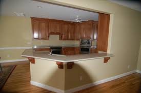 farmhouse design of small kitchen island with breakfast bar and