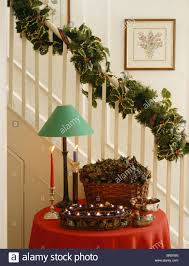 with garland on staircase above green l and