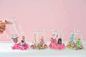 hello wonderful recycled plastic cup peg doll snow globe ornament