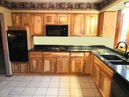 kitchen with hickory cabinets and black appliances a kitchen