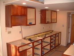 installing a kitchen base cabinet springfield kitchen cabinet install remodeling designs inc